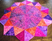 Perfectly Pretty Patchwork Table Topper in Purples, Pinks and Oranges by Sweet Tooth Quilts