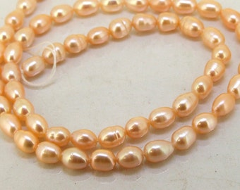 One strand Rice Natural Pink Freshwater Cultured Pearl Beads Gemstone 5mm-6mm  One Strand