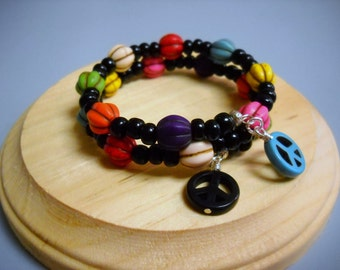 Multicolored Dyed Howlite Melon Beads, Opaque Black E Beads, Dyed Howlite Peace Signs Memory Wire Bracelet