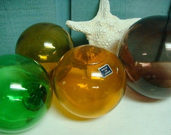 Glass Fishing Floats Japan Set of Four Orange Green Purple Brown Beach House Decor CastawaysHall