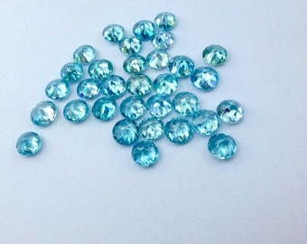 ZIRCON. Blue. Micro Facet.  Bright and Warm medium BLUE. Rounds Pairs and Singles 3 pc. 2.25 cts. 5mm  (ZIR126)