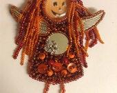 Dread beaded angel pumpkin head Halloween doll brooch
