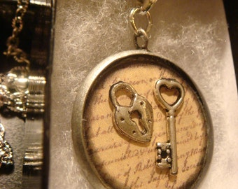 Key to My Heart Steampunk Pendant Necklace with Tiny Heart Key and Heart Lock  Over Script (1395)