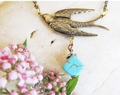 ON SALE Dove Charm Necklace ,brass swallow, turquoise bead,antique brass chain
