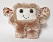 Furry plush monster: Julianna the beige soft fur toy
