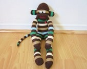 Mint chocolate sock monkey plush with brown, tan, cream, blue, and green stripes