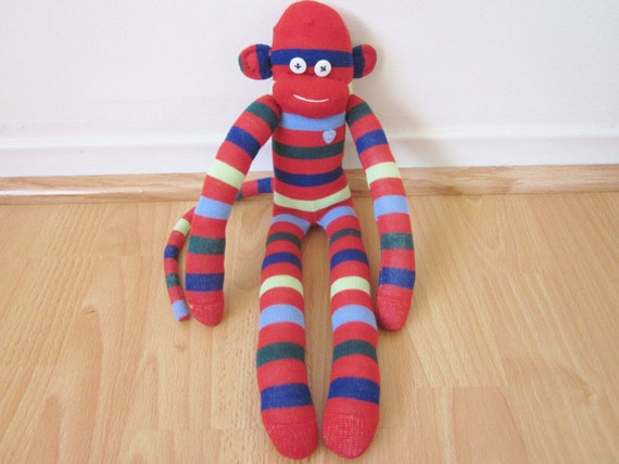 Red striped sock monkey plush doll with green and blue stripes