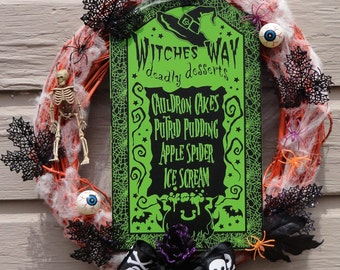 Halloween cobweb wreath, eyeballs, skeletons, witches way sign, black, green, orange