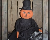 Soft Sculpted painted pumpkin doll in black and white