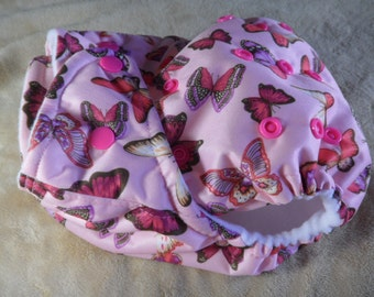 SassyCloth one size pocket diaper with butterflies on pink PUL print. Made to order.