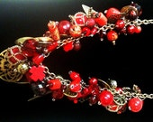 Chunky Bead Charm Necklace in a Variety of Reds and mixed metal charms