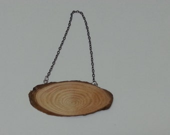 Unfinished Piece of Sliced Wood with a Chain