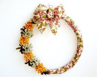 Fall Wreath Covered With Print Ribbon And Floral Embellishments