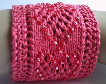 SALE. Hand knitted beaded heart cuff / bracelet.  Adult or teenager.  Salmon pink.