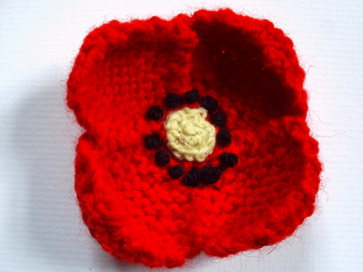 Hand knitted red poppy flower brooch. Made to order.