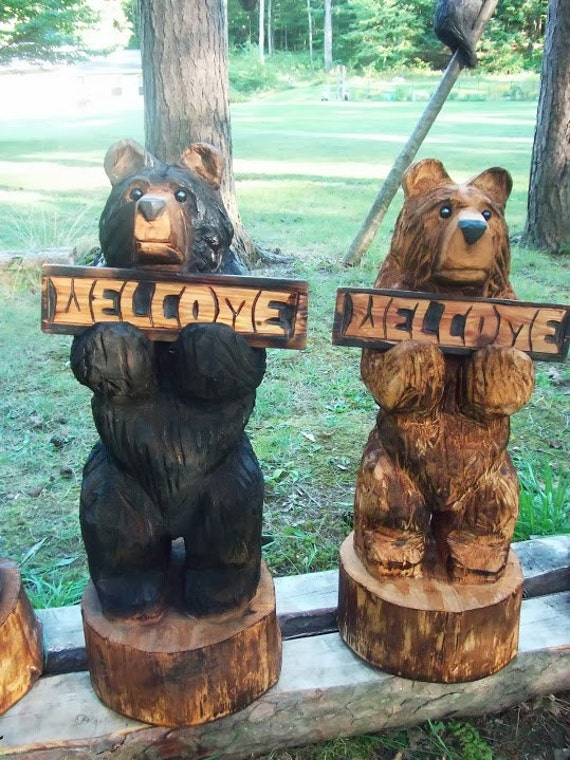 Chainsaw carved bear holding a welcome by