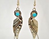 turquoise and sterling silver earrings.  hand fabricated.  'bluebird'