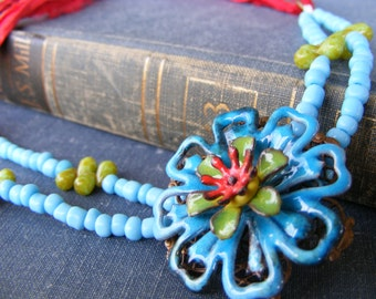 Gypsy Flower Necklace:  Enameled Flower Pendant with Sky Blue Lime Green Beads and Red Sari Silk Ribbon
