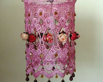 Sweet  and delightful Pink meringue, vintage style roses, in a pink lace hanging chandelier  lamp shade with Czech glass teardrops  beads .