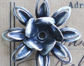 Lacey brass flower with bezel, riveted, Sterling Silver Finish
