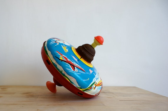 Best Retro Toys : Vintage spinning top french metal toy airplanes