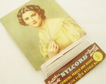 Vintage Nylcord thread for restringing pearls , lovely lady graphics