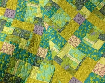 "Blue Green Patchwork With Hints of Purple and Sage Green Are Softly Blended Together In This 48"" X 71"" Quilt"