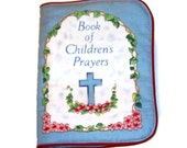 A Soft  Cloth Book of Children's Prayers with piping around the edges