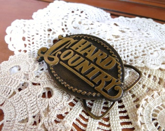 Hard Country Brass Belt Buckle  - 1980s ITC Films - Marble Arch Productions - Bergamot Brass Works INC - Made in USA