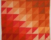 Orange gradient triangles quilt
