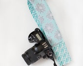 DSLR camera strap cover with lens cap pocket.  Aqua and grey roses and lattice.