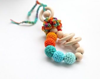 Teething toy rattle with crochet wooden beads and 3 wooden rings. Mint, orange, teal.