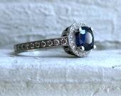 Stunning Halo Pave Diamond and Sapphire Ring.