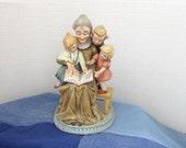 Vintage Ceramic Figurine Grandma Reading to Children c1960