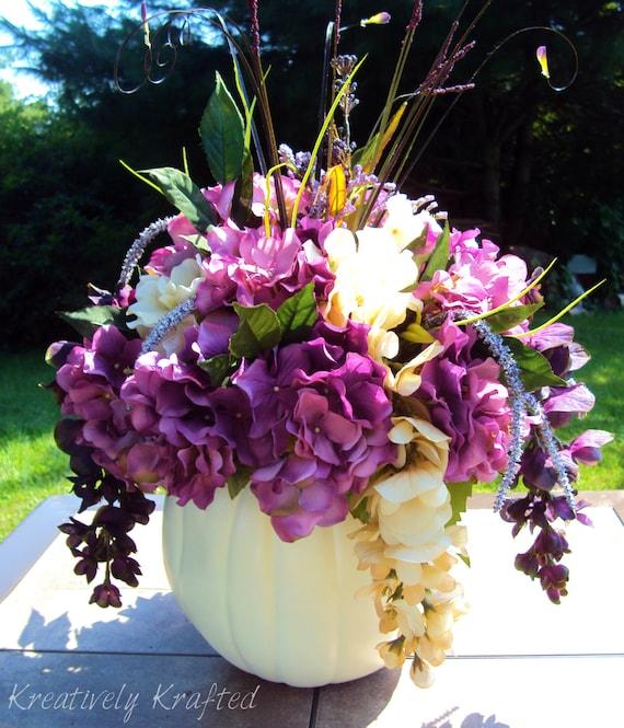 White cream purple pumpkin flower table by