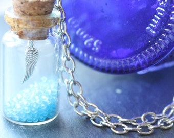 Miniature Bottle Filled with Blue Glass Beads and Wing. Bottle Jewellery- Seaside Nautical Theme, Fairytale Jewelry.