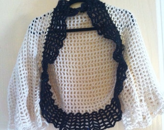 Hand crocheted shawl with midarm sleeves and ruffled collar and edging