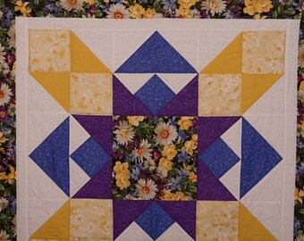 Purple, blue and yellow wall hanging quilt