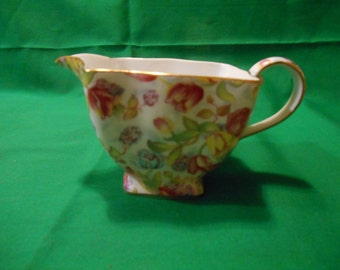 One (1), 6 oz., Porcelain Creamer, from Royal Cotswolds, in a Tulip Chintz Pattern.