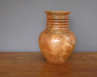 Wood vase made from cherry wood, decorative turned wood, rich reddish brown colors, hollow form