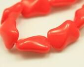 Bead, Preciosa® Czech pressed glass, opaque orange, 14.5x9.5x6.5mm twist. Qty 9, Czech Glass Bead