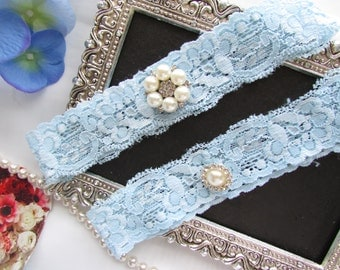 SALE Blue Bridal Garter Set - Pearl Silver Metal Rhinestone applique on a blue Lace