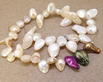 One Full Strand--- Dancing White Lavender Pure Freshwater Pearl----5-8mm----about 42Pieces----11 inch strand