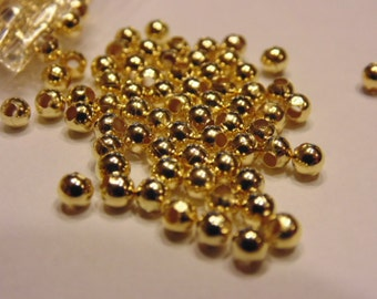 100 gold plated spacer beads, 3 mm