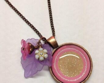 Glass pendant: pink sparkles