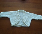 Hand knit ivory baby girl shrug