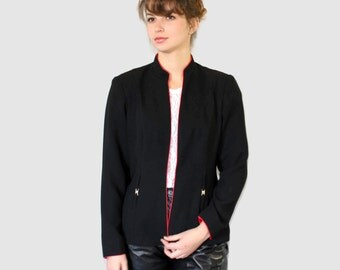 Vintage black jacket. Open front jacket by Receptions New York. Red piping. Gold metal rhinestones embellishments. Size 8.