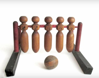 Antique Bowling Game. Stand, Tumbling Pins and Wooden Ball. Arcade.