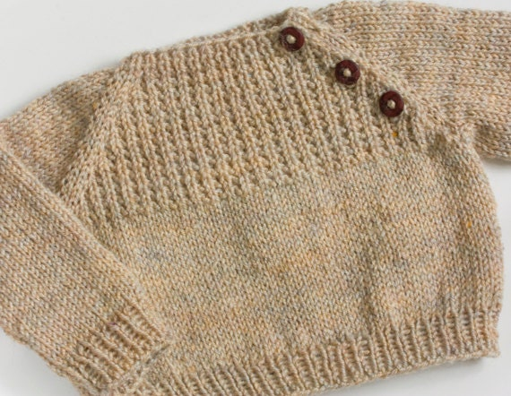 A knitted baby sweater is a great transition project for a knitter who has the skills, but doesn't yet want to commit to a full size adult sweater.