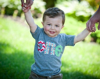one lowercase with red chevron, pez and green circles for boys 1st Birthday Shirt